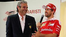 Nach Baldisserris Meinung, leidet das Ferrari-Team mit Maurizio Arrivabene (l.) und Sebastian Vettel (r.) unter mangelnder Innovation.