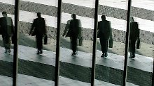 Business-Mann im Spiegel