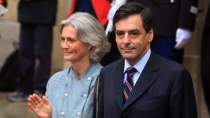 In schwerer Bedrängnis: François Fillon mit seiner Frau Penelope.