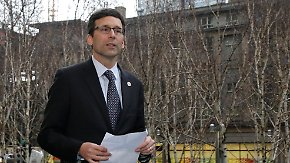 Washington Attorney General Bob Ferguson arrives to talk to reporters, following a hearing in federal court Friday, Feb. 3, 2017, in Seattle. A U.S. judge on Friday temporarily blocked President Donald Trump's ban on people from seven predominantly Muslim countries from entering the United States after Washington state and Minnesota urged a nationwide hold on the executive order that has launched legal battles across the country. (AP Photo/Ted S. Warren)