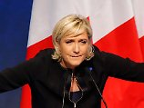 """Far-right leader presidential candidate Marine Le Pen gestures as she speaks during a conference in Lyon, France, Sunday, Feb. 5, 2017. Britain's decision to leave the European Union and the election of U.S. President Donald Trump have given the French a """"reason to vote"""" because it can result in real change, the top lieutenant of far-right French presidential candidate Marine Le Pen declared Sunday ahead of her long-awaited speech. (AP Photo/Michel Euler)"""
