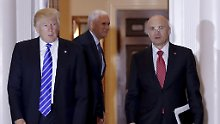 FILE - In this Nov. 19, 2016 file photo, President-elect Donald Trump walks Labor Secretary-designate Andy Puzder from Trump National Golf Club Bedminster clubhouse in Bedminster, N.J. Puzder said Tuesday, Feb. 7, 2017, that a housekeeper he had previously employed at his home was an undocumented worker, potentially complicating his efforts to get confirmed.  (AP Photo/Carolyn Kaster, File)
