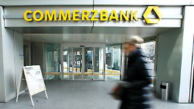 A woman walks past a branch of Commerzbank before the bank's annual news conference in Frankfurt, Germany, February 9, 2017. REUTERS/Ralph Orlowski