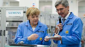 Auswahl kein Zufall: Merkel reist mit drei Wirtschaftsbossen zu Trump