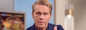 Mit blauem Auge auf Sendung: Prügelopfer Baumgarten moderiert wieder