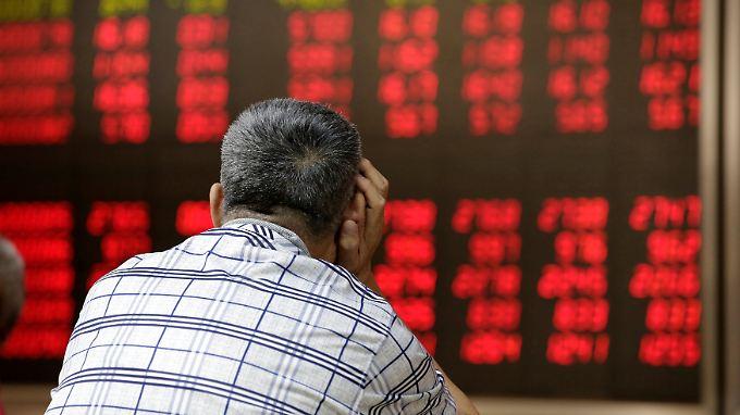 Sorgenvoller Blick auf die Kurse in Peking.
