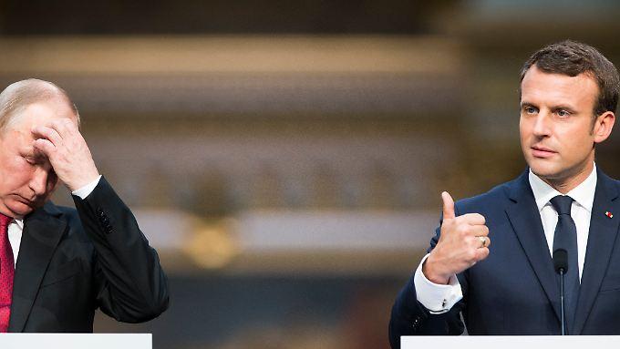 Russlands Präsident Wladimir Putin und Frankreichs Staatschef Emmanuel Macron legen den Wahlkampf zu den Akten.