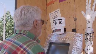 BlessU-2 kann sogar Hessisch: Priester-Roboter segnet Gläubige