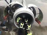 Lebensgefährlicher Aberglaube: Frau wirft Münzen in Flugzeugturbine