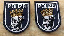 Kopulierende Bären auf Wappen: Posse um Party-Polizisten geht weiter
