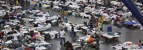 Ausgangssperre in Houston: Trump verspricht Hochwasseropfern Hilfe
