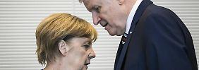 Kurswechsel der Unionsparteien: Seehofer und Merkel ringen mit der Basis
