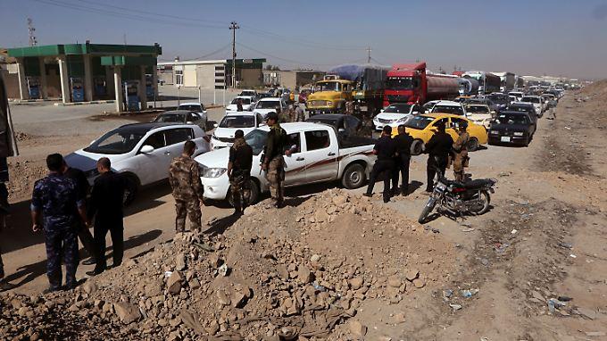 Einwohner, die vor den Kämpfen geflohen waren, kehren nach Kirkuk zurück.