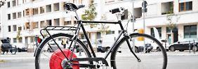 Roter Diskus mit E-Bike-Power: Copenhagen Wheel verleiht Rädern Flügel