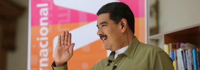 Die drohende Staatspleite lässt Nicolas Maduro kalt. Investoren sind anderer Meinung.