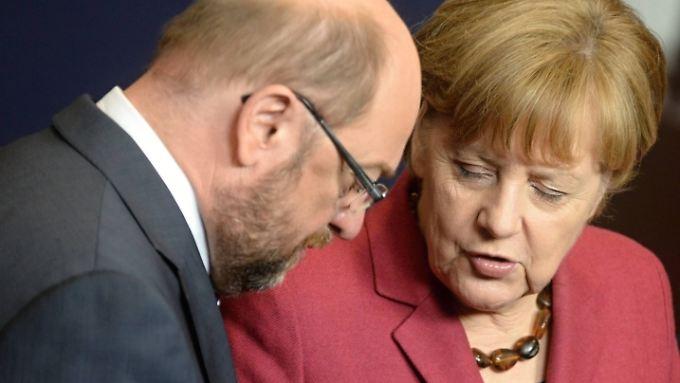 Schulz und Merkel im Bundestag.