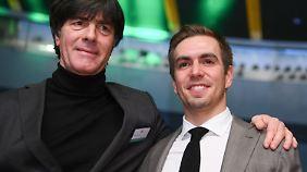 Zusammen feierten Löw und Lahm den größten Erfolg - Weltmeister 2014.