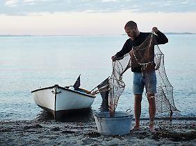 Die Bilder von Anders Schønnemann vermitteln die Gelassenheit eines Mannes am Meer.