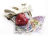 Bargeld lacht: Deutsche lieben Scheine und Münzen