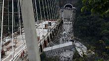 Tödliches Unglück in Kolumbien: Riesige Brücke begräbt Arbeiter unter sich
