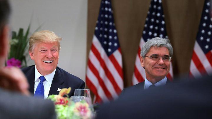 Donald Trump und Siemens-CEO Joe Kaeser beim gemeinsamen Dinner mit Konzernchefs in Davos.