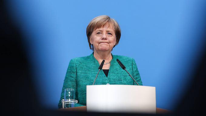 Angela Merkel hat viel gegeben, um Kanzlerin bleiben zu können.