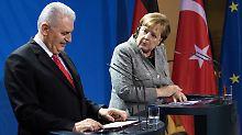 Mevlüt Yildirim und Angela Merkel - in abgegrenzter Arbeitsatmosphäre.
