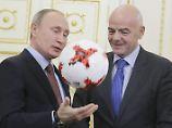 Wladimir Putin und Gianni Infantino glauben an ein sicheres Turnier.