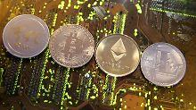 Der Börsen-Tag: Google verbannt Werbung für Bitcoin und seine Brüder