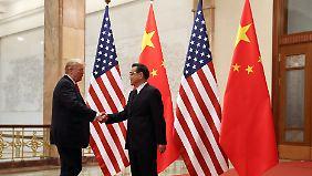 Wie ernst ist der Streit zwischen China und den USA? Hier die Begegnung von Xi Jinping (r) mit Donald Trump im vergangenen November.
