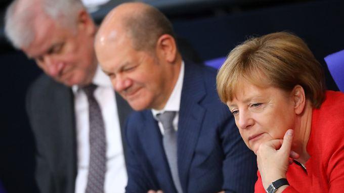 Angela Merkel, Olaf Scholz und Horst Seehofer sind sich offenbar einig.