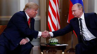Donald Trump und Wladimir Putin vorm Beginn ihres Vieraugengesprächs.