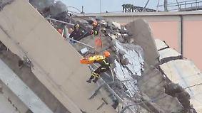 Ponte Morandi in Genua: Rettungskräfte suchen in Brückentrümmern nach Überlebenden