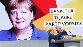 Zehn Minuten stehende Ovationen: Merkel nimmt emotional Abschied von CDU-Führung