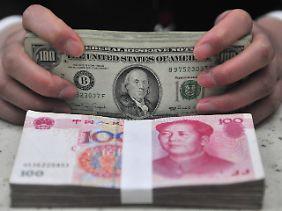 Währungsstreit: Im Vergleich zum US-Dollar, so der Vorwurf, soll der chinesische Yuan unterbewertet sein.