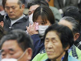 Proteste vor der Tepco-Zentrale in Tokio. Die Geschädigten verlangen Schadenersatz von der AKW-Betreiberfirma.