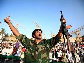Geschafft: ein libyscher Aufständischer in Tripolis.