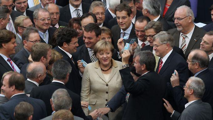 Geschafft: Die Mehrheit war schnell klar im Bundestag, schließlich auch die für Merkel so wichtige Kanzlermehrheit.