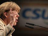 Merkel deutet einen höheren Schuldenschnitt für Griechenland an.