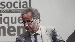 Mit Mehl und Glitter: Hollande und Romney attackiert