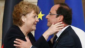 Hollande und Merkel feiern Freundschaft: Herzlichkeiten in Reims
