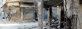 Auch in der Rebellenhochburg Homs sind etliche Häuser und Geschäfte zerstört.
