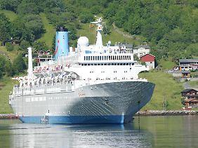 Kreuzfahrtschiffe sind in Bergen ebenso häufig zu sehen wie im Geirangerford.