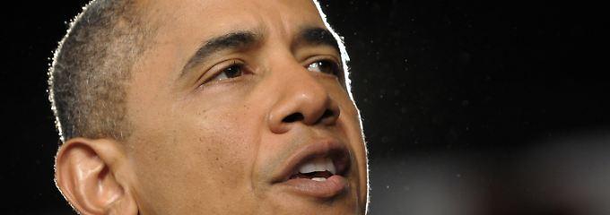 Barack Obama bekennt sich zum Christentum - viele seiner Landsleute glauben ihm aber nicht.