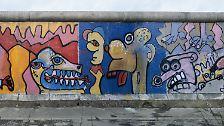Kritzler und Künstler: Die Berliner Mauer in Bunt