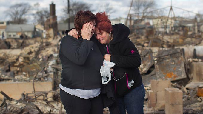 Die US-Amerikaner an der Ostküste leiden - weil sie Angehörige verloren haben oder ihr Heim.