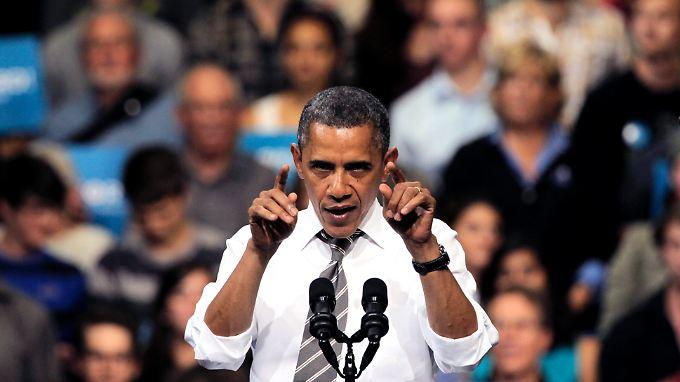 Brack Obama freut sich über neu geschaffene Jobs.
