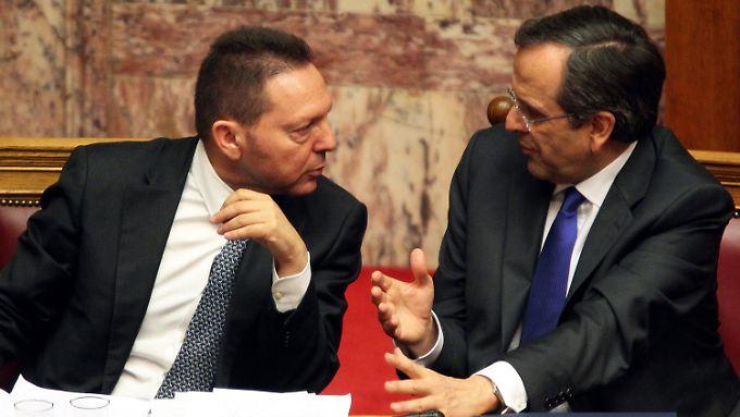 Verwalter leerer Kassen: Ministerpräsident Antonis Samaras (rechts) und Finanzminister Yannis Stournaras.
