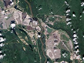 Der Abbau der Ölsande am Fluss Athabasca in der kanadischen Provinz Alberta erstreckt sich über ein Gebiet, das größer ist als Bayern. Und die Fläche wächst noch immer.