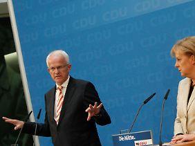 Rückendeckung: Rüttgers darf auch mit Merkels ausdrücklicher Unterstützung im Amt bleiben.